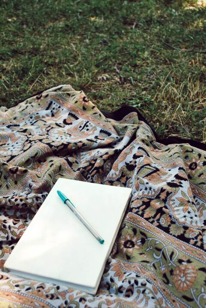 Journal on a tapestry waiting for someone to start writing