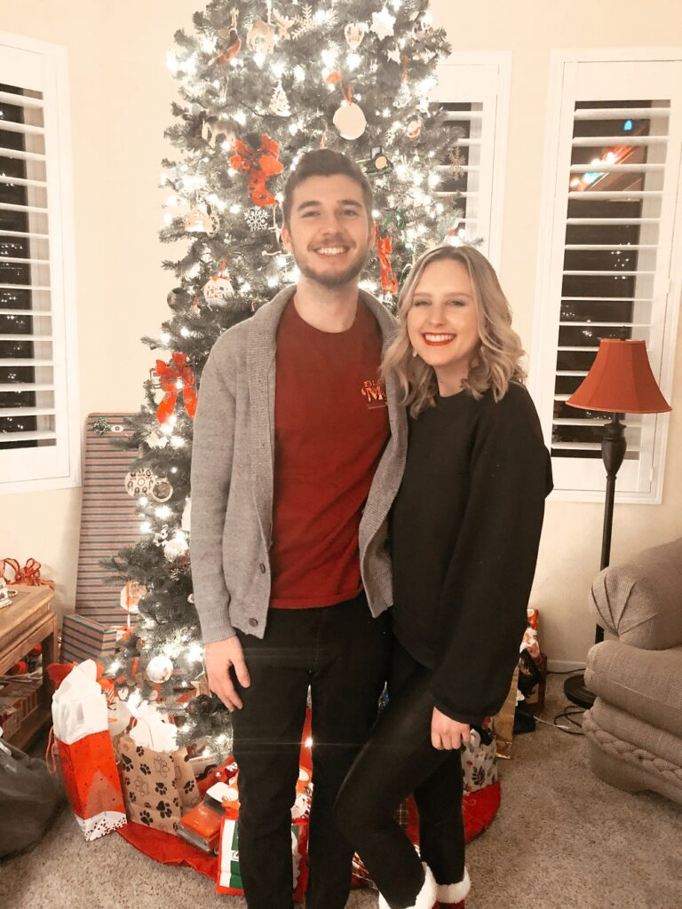 Couple in front of a Christmas tree in 2020