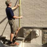 GardenWise landscape design build - carpenter, checking some measurements. Northern Virginia, Washington D.C