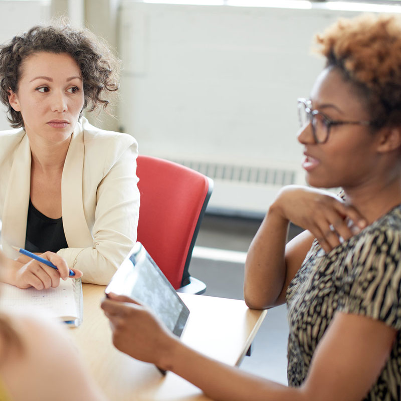 Women collaborating in workplace