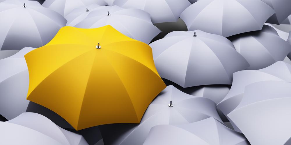 yellow umbrella among gray