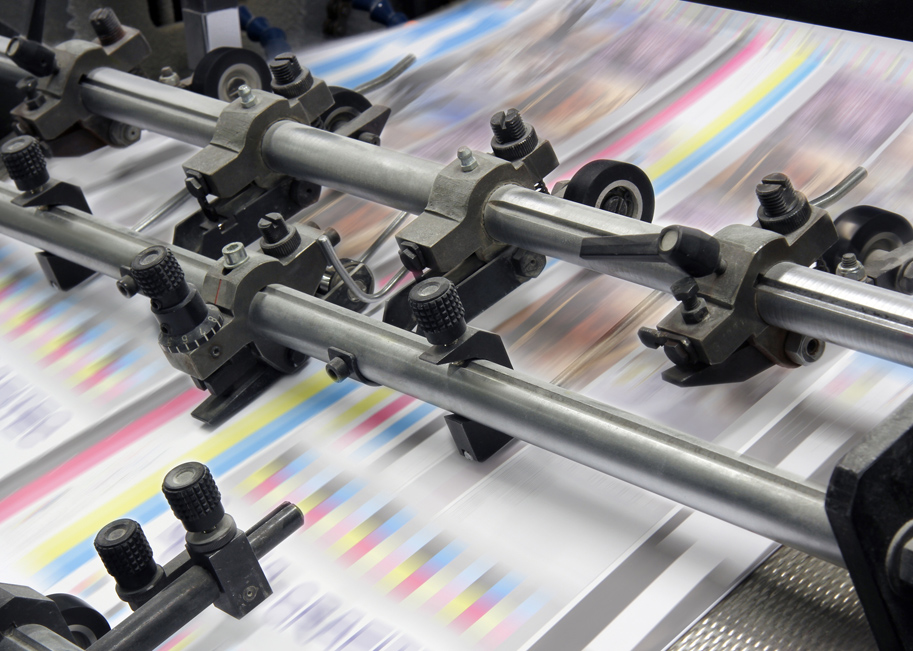 Photo of printing press in action.