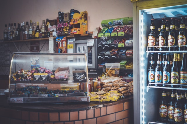 Grocery store, drink cooler, food racks, deli counter