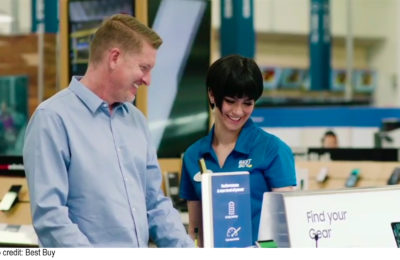 Best Buy employee assisting a customer