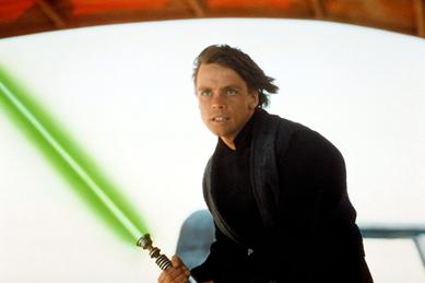 Luke Skywalker with his lightsaber in Star Wars. Via forcematerial.com.