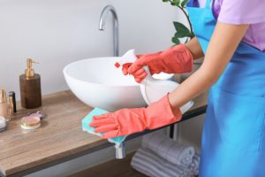 Disinfecting a bathroom
