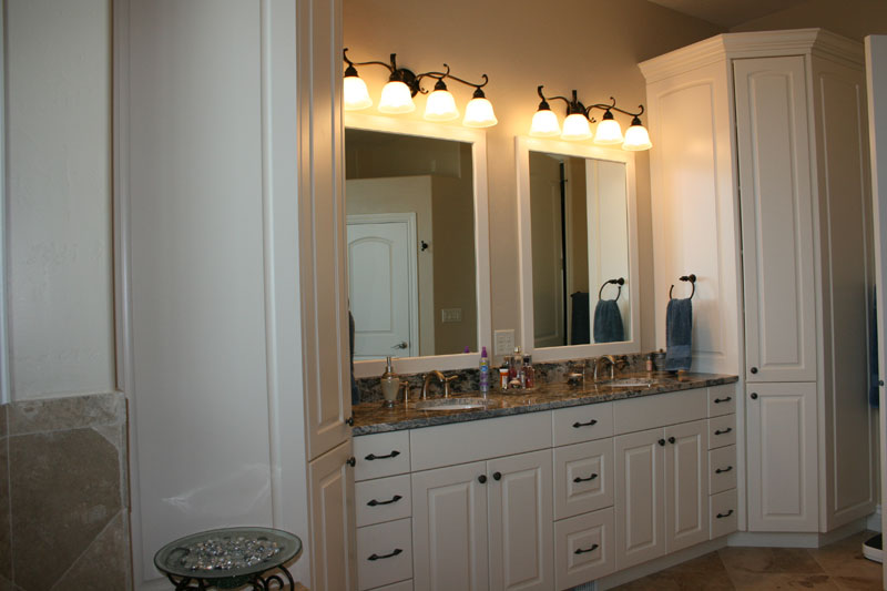 white cabinets in master bathroom
