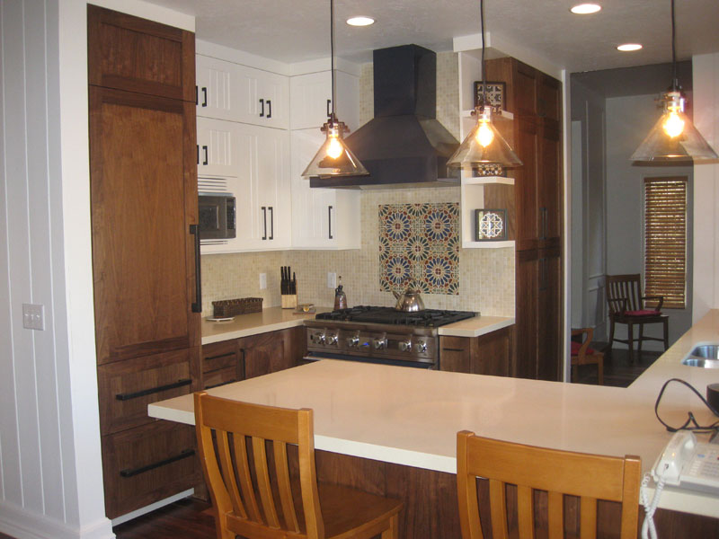 dual tone kitchen with mosaic tile