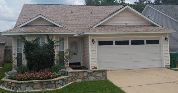 Image of a home roofed with Duration Amber shingles by Taylor Enterprises Inc.