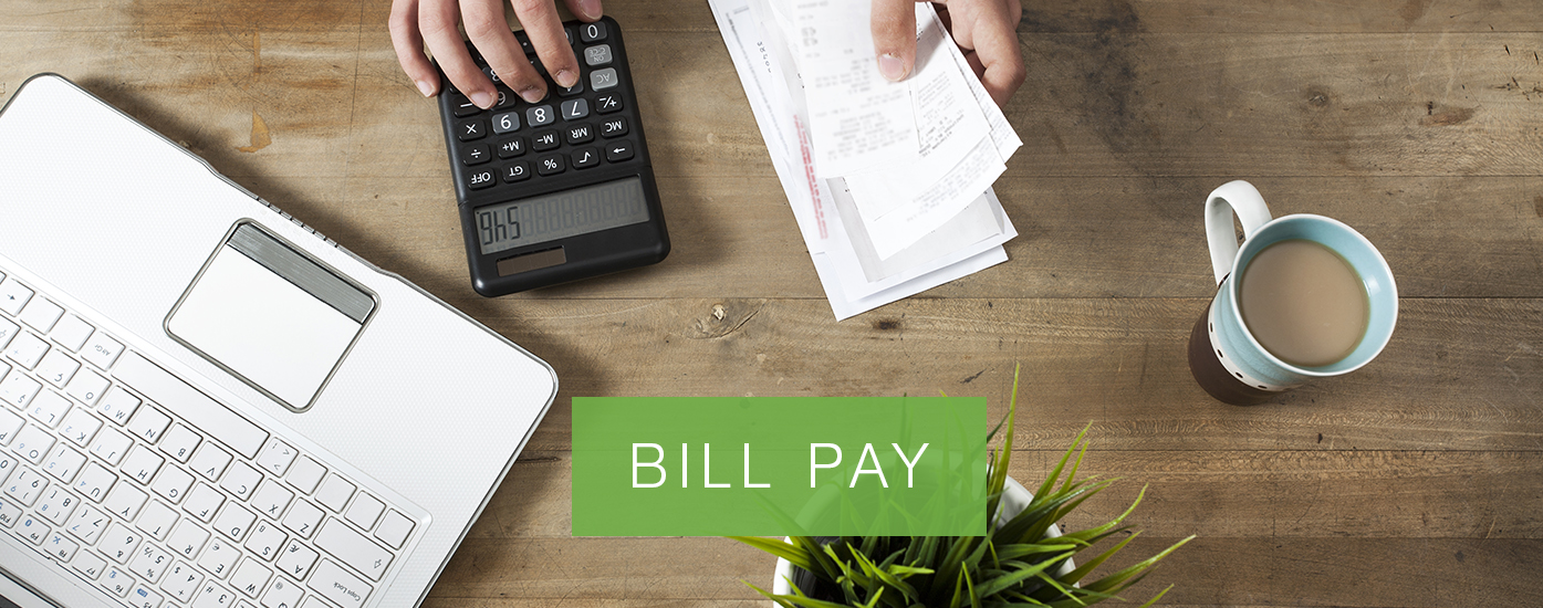 """Person paying bills with calculator and laptop and a cup of coffee. Banner reads """"BILL PAY"""""""