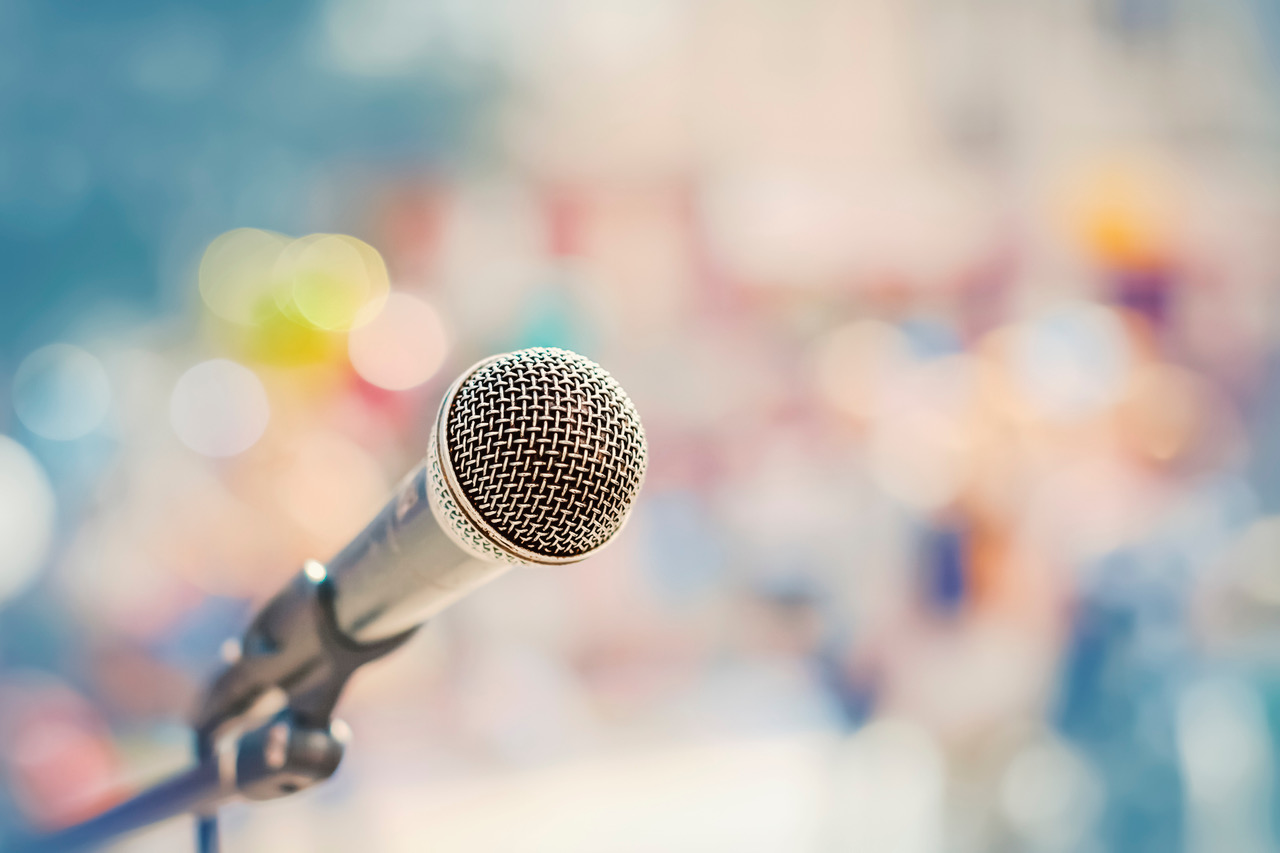 Microphone on the stand on the background of the street in defocus