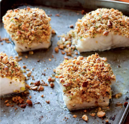 Plated shot of baked pollock with lemon bread crumbs