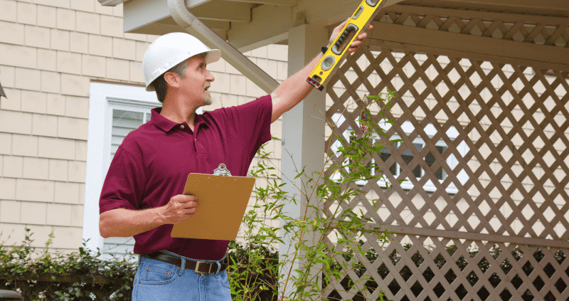 property inspector holding a clipboard