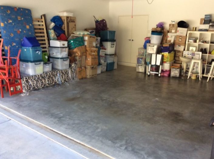 Stored goods against the internal garage walls and garage cupboard