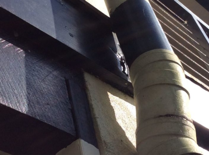 Wood decay to the rear timber fascia behind gutter down pipe