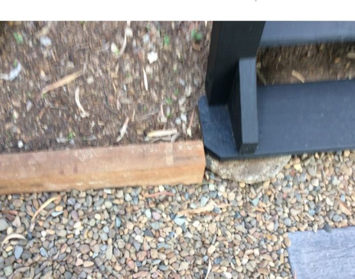 Base of external,staircase wood decay to stringer and timber tread lower soil to be at least 75 mm above surface ground clearance