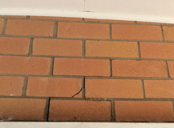 Crack to brickwork over old meter box