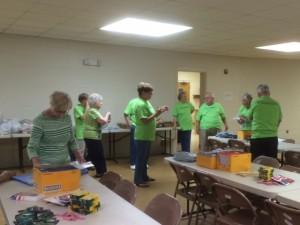 Friendship Class members preparing to assemble school kits