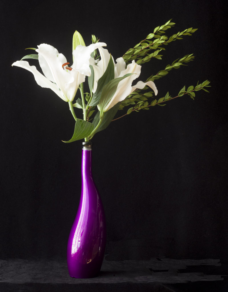 White Asiatic Lilies in a Purple Vase