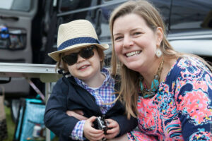 Woman with small child dressed up for the Foxfield Races