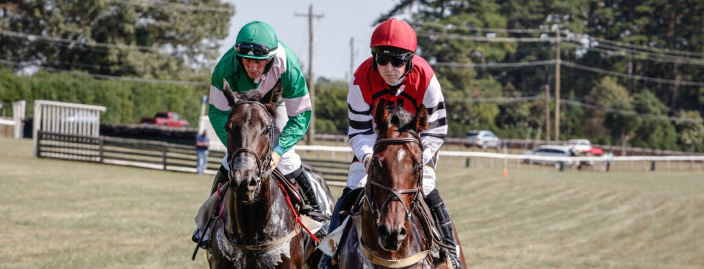 Horses racing neck to neck at foxfield.