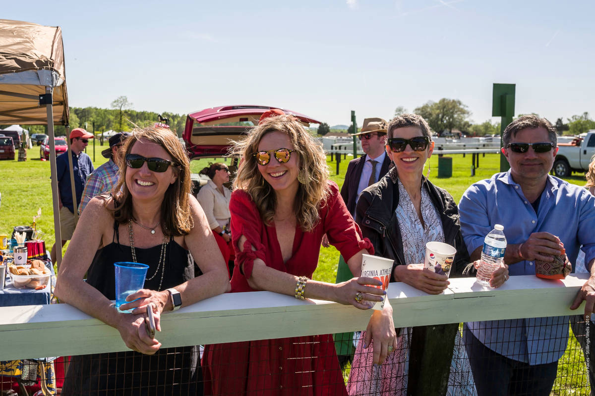 Onlookers lean on the race rail at Foxfield