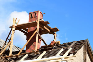 chimney on roof being repaired