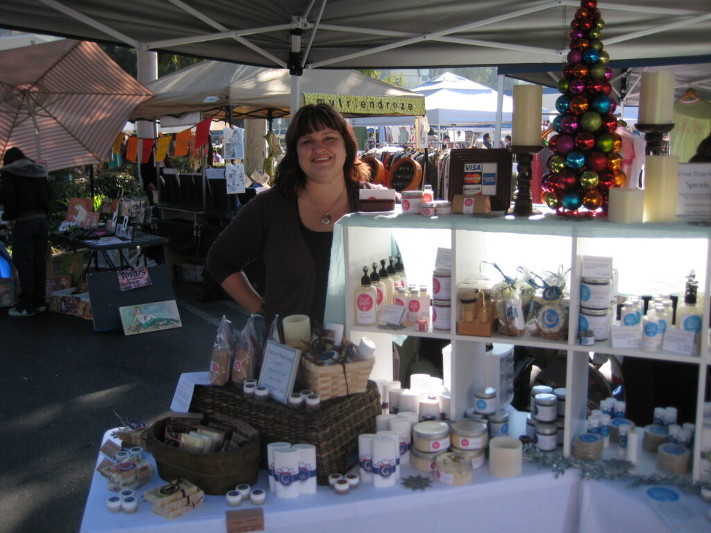Lauren behind her table of RitualBath lotions and soaps at the SilverLake Ghetto Gloss sponsored flea market