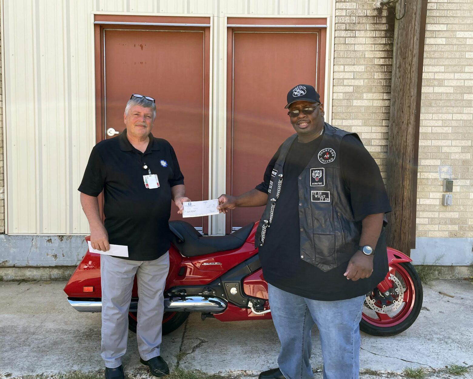 BCMC donates to Wolf Pack MC for school supplies for children in need