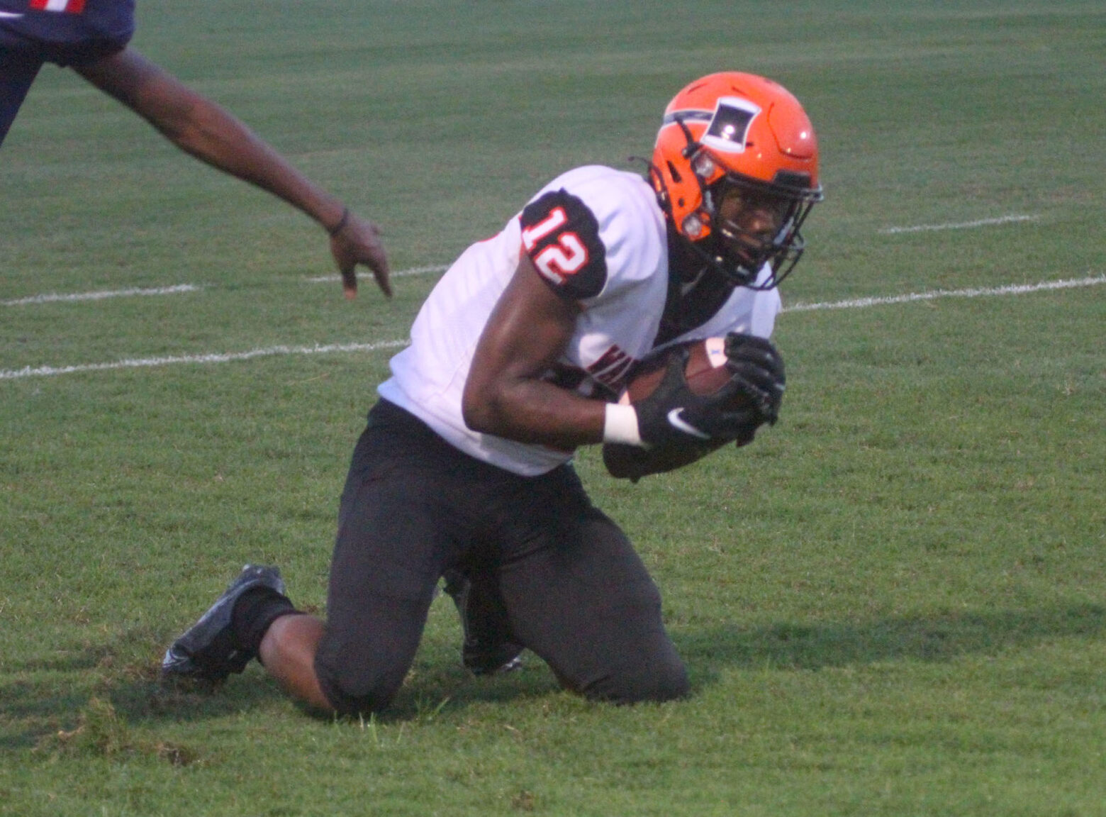 Historic first out-of-state football game ends in big win for Warren