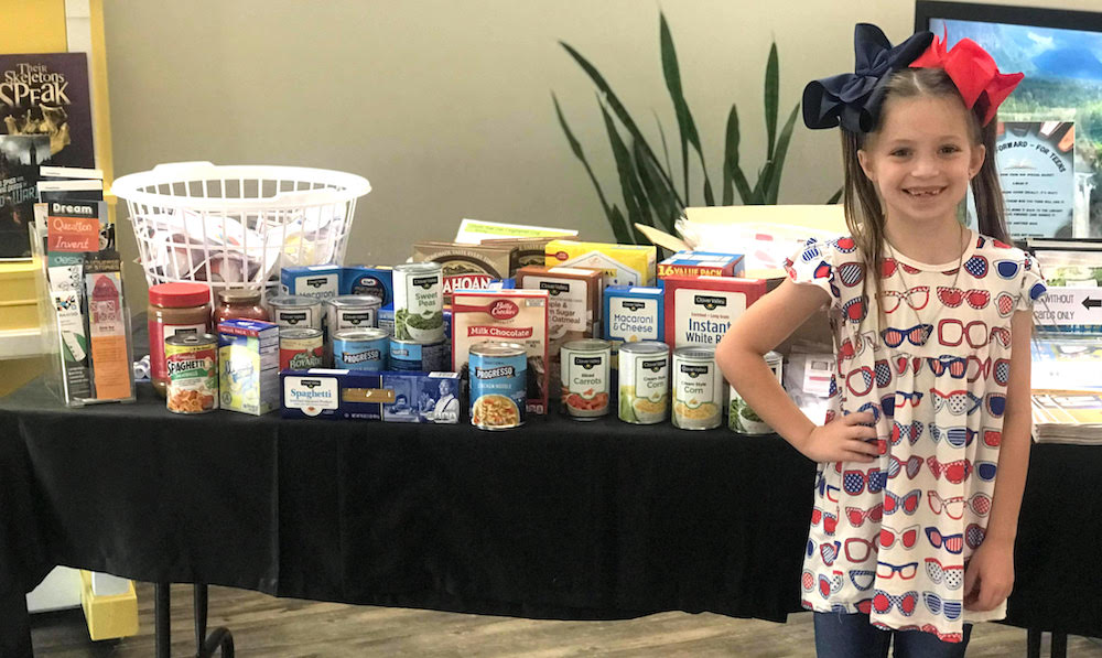 Local youth uses birthday money to buy food for the Blessing Box