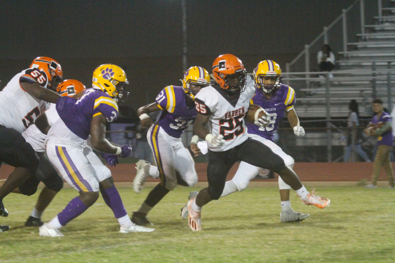 Ground game and high intensity defense showcase in Warren's fifth consecutive win