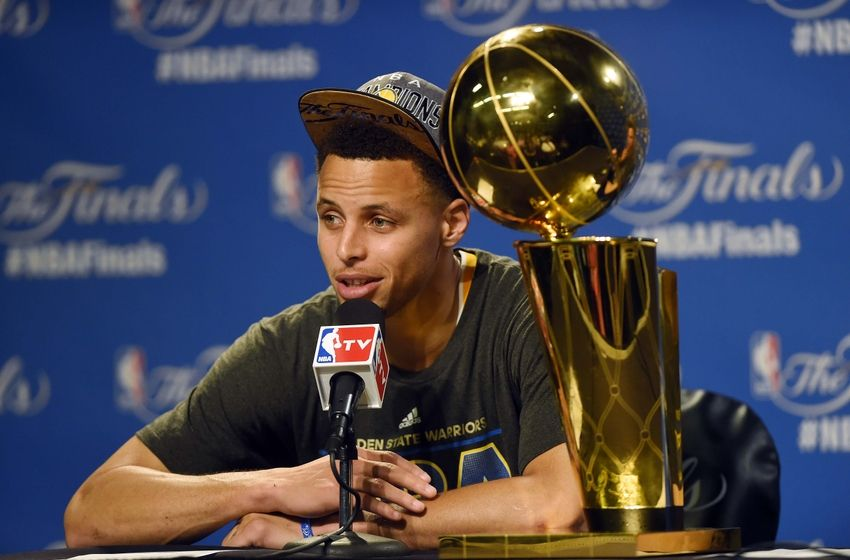 Stephen Curry with NBA Finals trophy