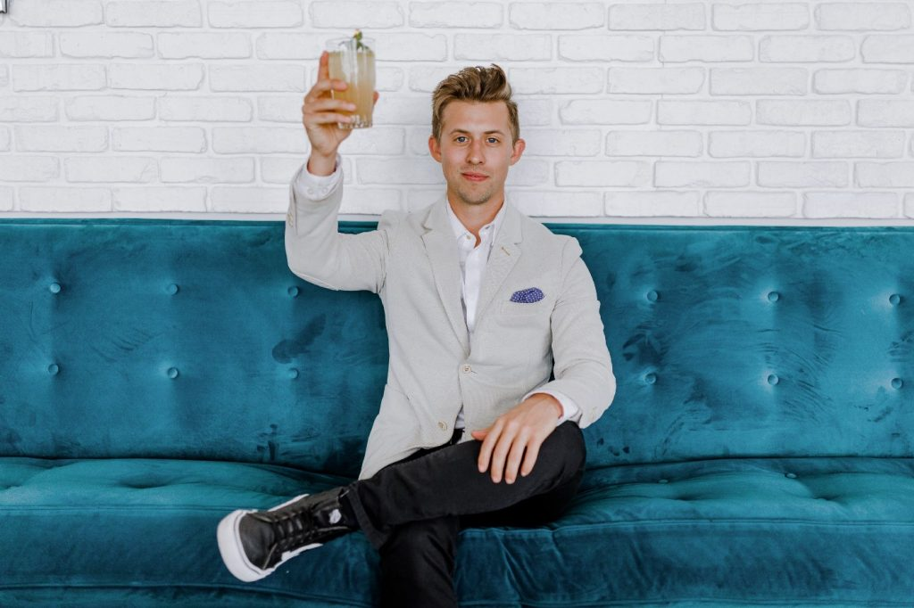 Man toasting his glass.