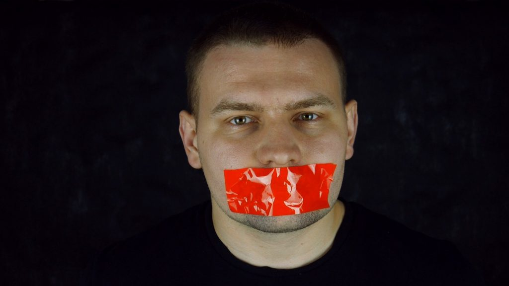 Guy with tape over his mouth - silenced