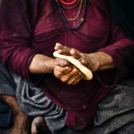 Woman shaping bread