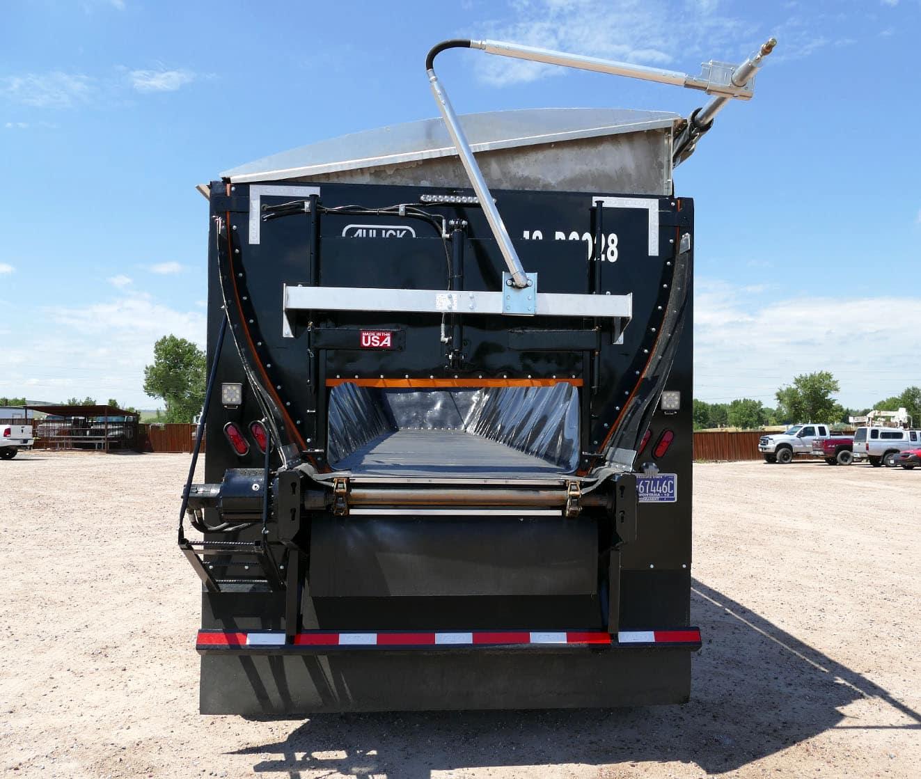 Aulick self unloading belt trailer