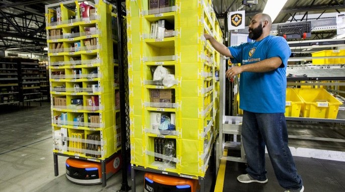 Kiva robots and an Amazon employee (Business Wire)