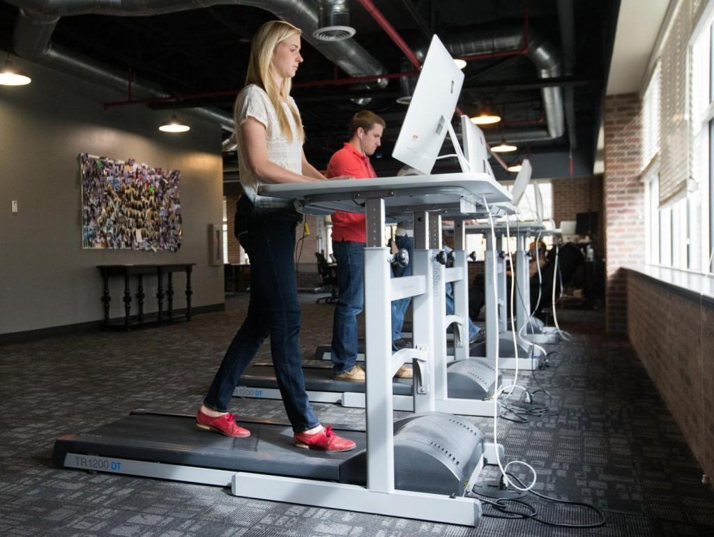 Employees work on treadmill desks at a local company. (Jaren Wilkey/BYU)
