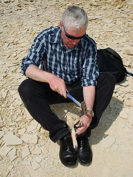 Steven learning to split Solnhofen limestone in one of the area quarries. Unfortunately, he found nothing more interesting than a plant fossil.