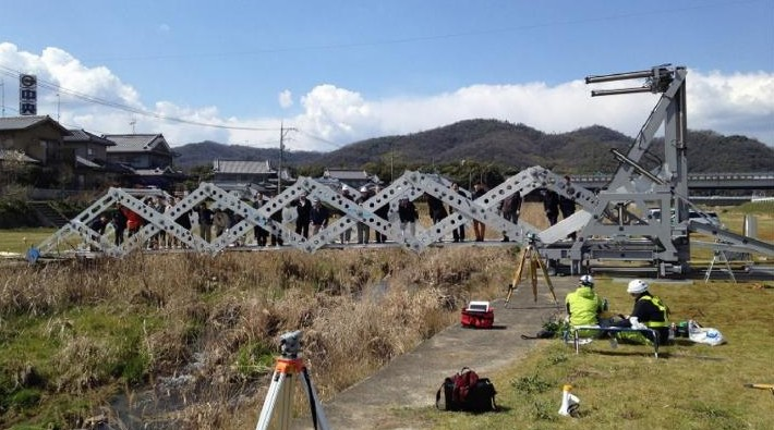 People walked over the Hongo River in Fukuyama City, Japan on the MB4.0 temporary bridge. (Photo courtesy of Hiroshima University, Japan Construction Method and Machinery Research Institute, Hoshikei-kinzoku Industry Co.,Ltd., Akashin Co.,Ltd., Sankyo Tateyama, Inc., and Yokoyama Kisokouji Co.,Ltd.)