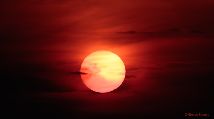 Sunsets: Sunset seen at the coast in Novigrad, Croatia. Thin clouds turn a normal sunset into a sci-fi worthy sunset. [EOS 7DmkII: 400mm, f5.6, ISO 100, 1/2000 sec]