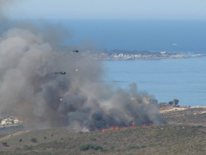 Fire Management in California's Chaparal: The U.S. Army Corps of Engineers Sacramento District conducted a controlled burn of central marine chaparral at Fort Ord, Calif., Oct. 15, to expose unexploded ordnance at the formerly utilized defense site. The burn, carefully coordinated with local agencies, lasted less than two hours and was timed so that prevailing winds would help blow the smoke away from population centers. The controlled burns are part of a comprehensive ordnance removal program at Fort Ord, which closed in 1994 under recommendation from the Base Realignment and Closure Commission. (U.S. Army photo/Released)