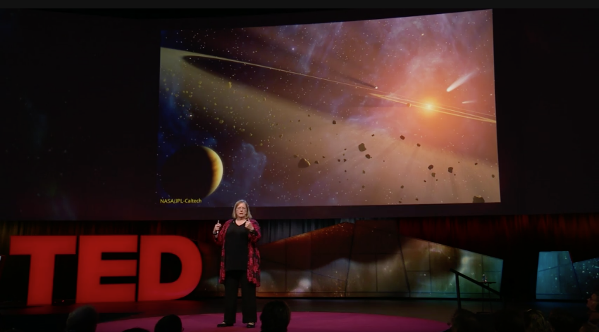 """In October 2017, astrobiologist Karen J. Meech got the call every astronomer waits for: NASA had spotted the very first visitor from another star system. The interstellar comet -- a half-mile-long object eventually named `Oumuamua, from the Hawaiian for """"scout"""" or """"messenger"""" -- raised intriguing questions: Was it a chunk of rocky debris from a new star system, shredded material from a supernova explosion, evidence of alien technology or something else altogether? In this riveting talk, Meech tells the story of how her team raced against the clock to find answers about this unexpected gift from afar. This talk was presented at an official TED conference"""