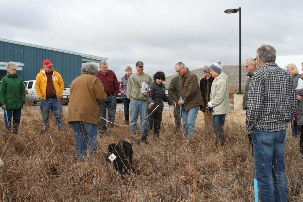 A large group of volunteers taking ground measurements as part of the MO Dirt program.
