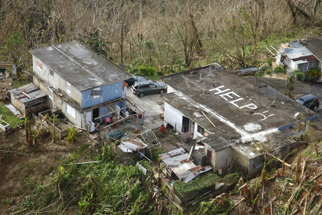 While conducting search and rescue in the mountains of Puerto Rico a CBP Air and Marine Operations Black Hawk located this home a half mile from its peek with HELP painted it is roof.