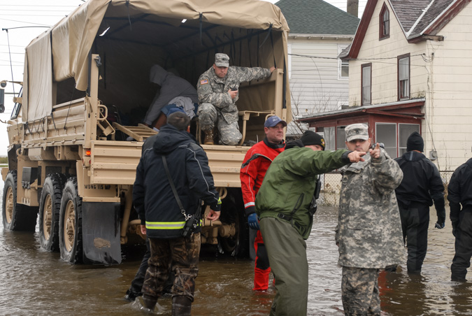 Members from several Maryland National Guard units are deployed to Crisfield, Md., to assist local authorities with house-to-house evacuations on Oct. 30, 2012. Guard members helped first responders evacuate senior citizens, families and children in the wake of Hurricane Sandy.