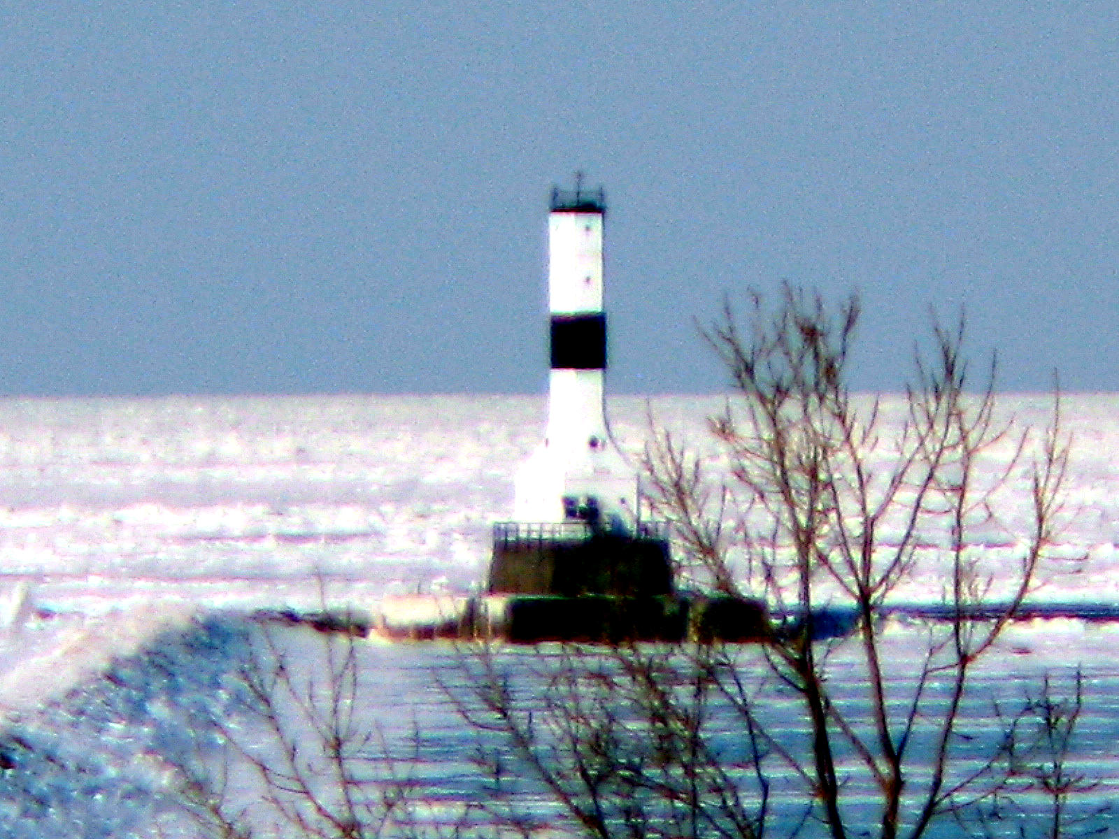 Lake Erie Dead Zone: A lighthouse on frozen Lake Erie, photo by George Bannister