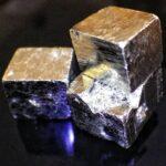 Hiddlen value of fool's gold: Macro photo of three Iron pyrite cubes by Stuart Rankin
