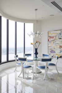 Contemporary dining room with window wall.